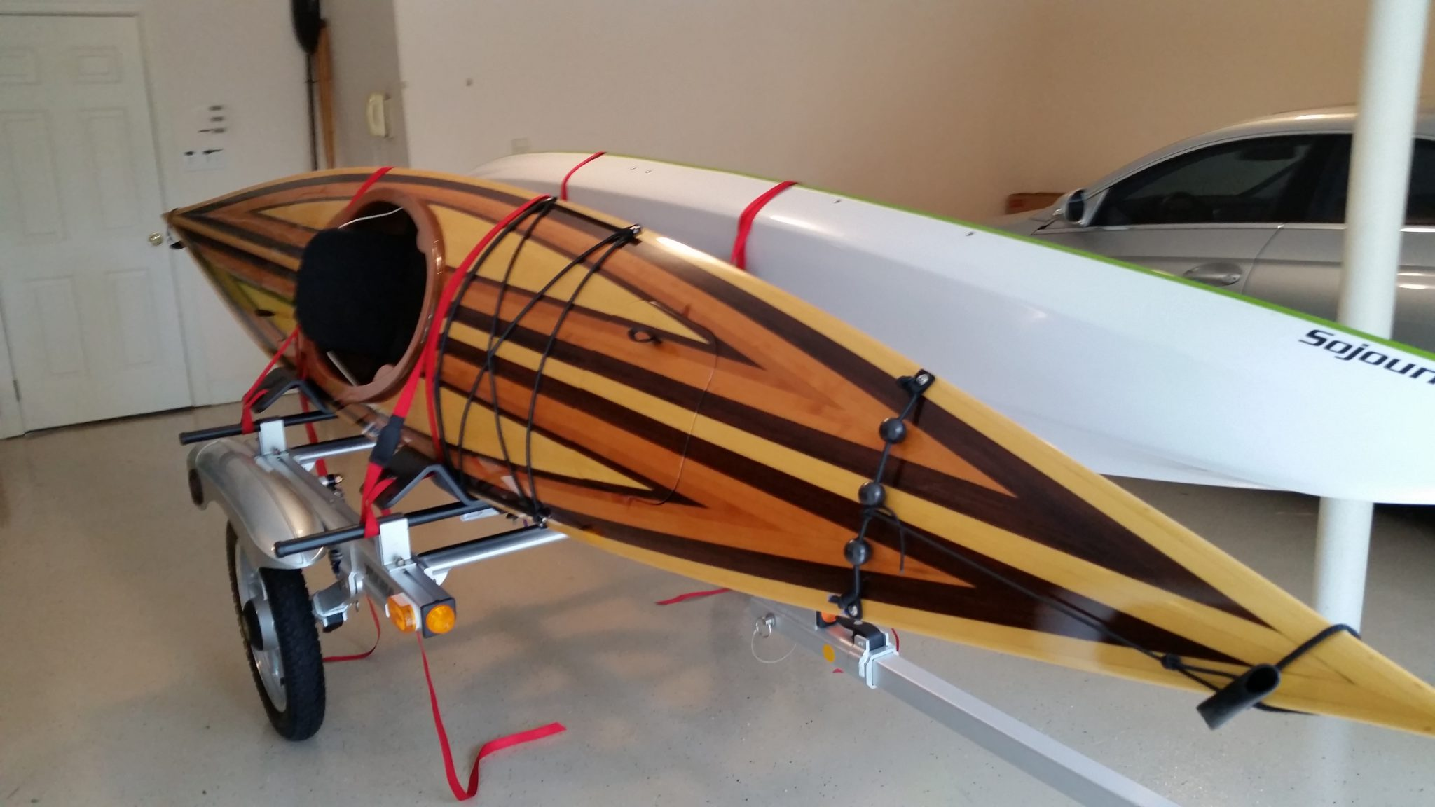 Kayak with multiple types of wood