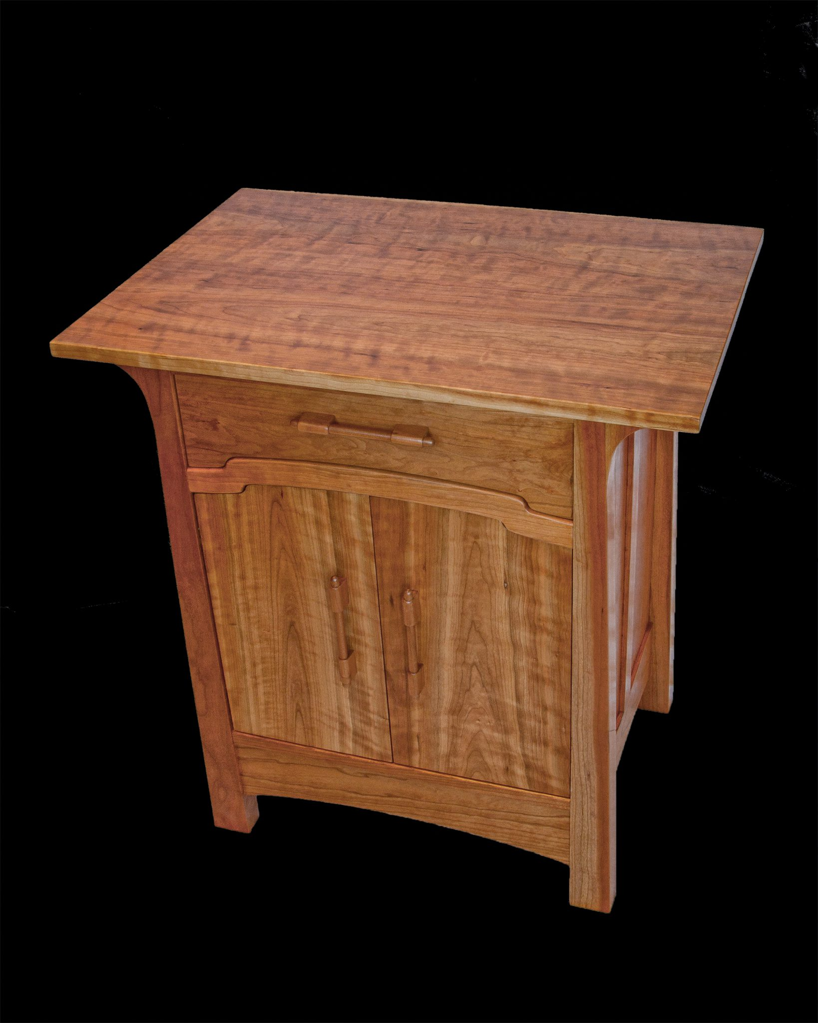 Arts and Crafts style cabinet in native cherry designed and built by Dick Glover, Emmett Eldred, Sam Everitt and Steel King. Donated to Safe Shelter for auction