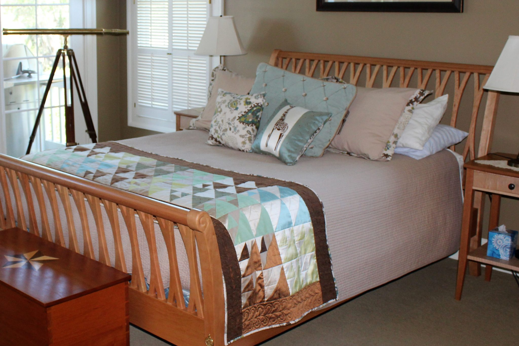 Cherry sleigh bed with curved posts