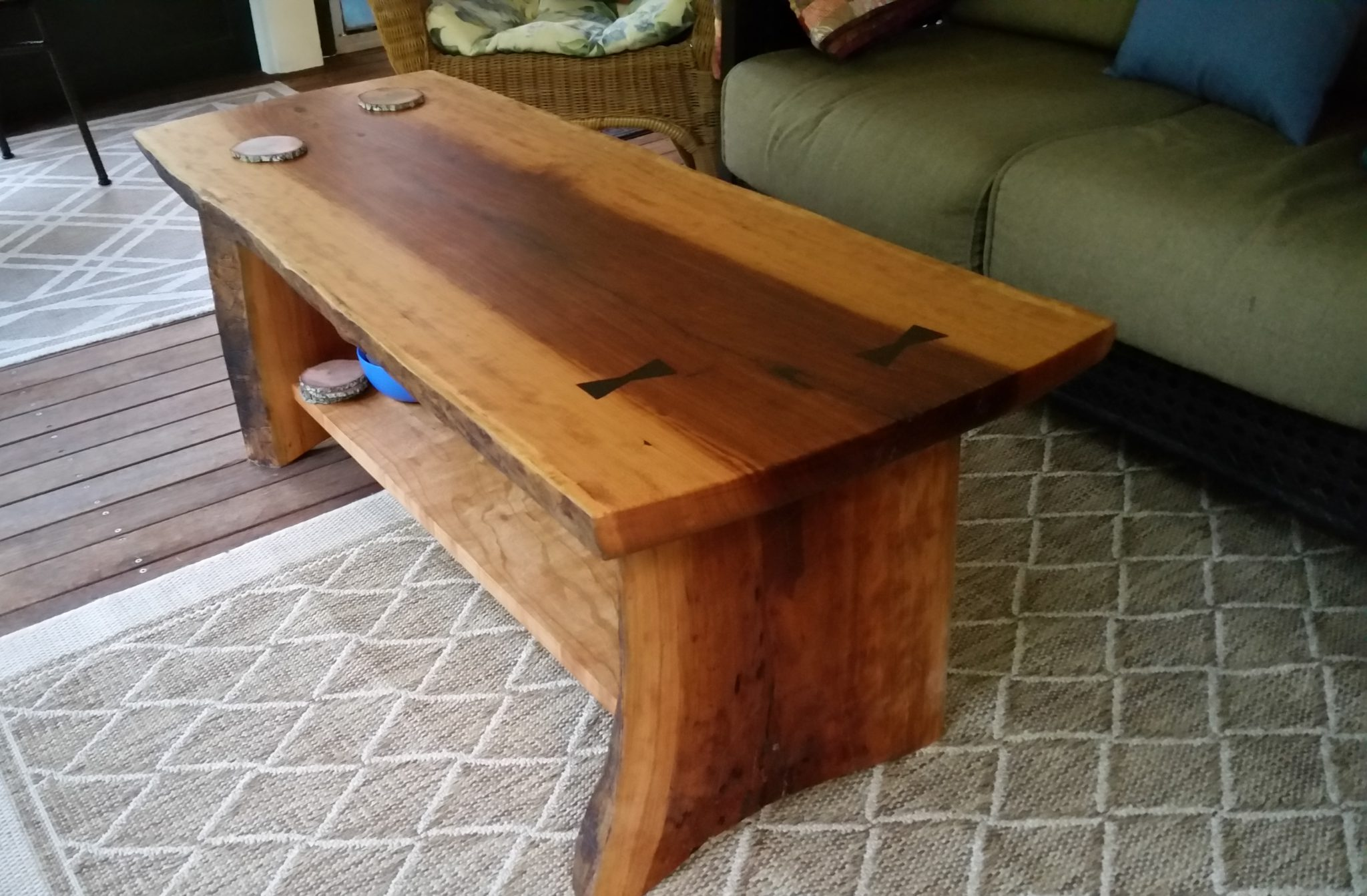Live edge coffee table with wenge bowties inset