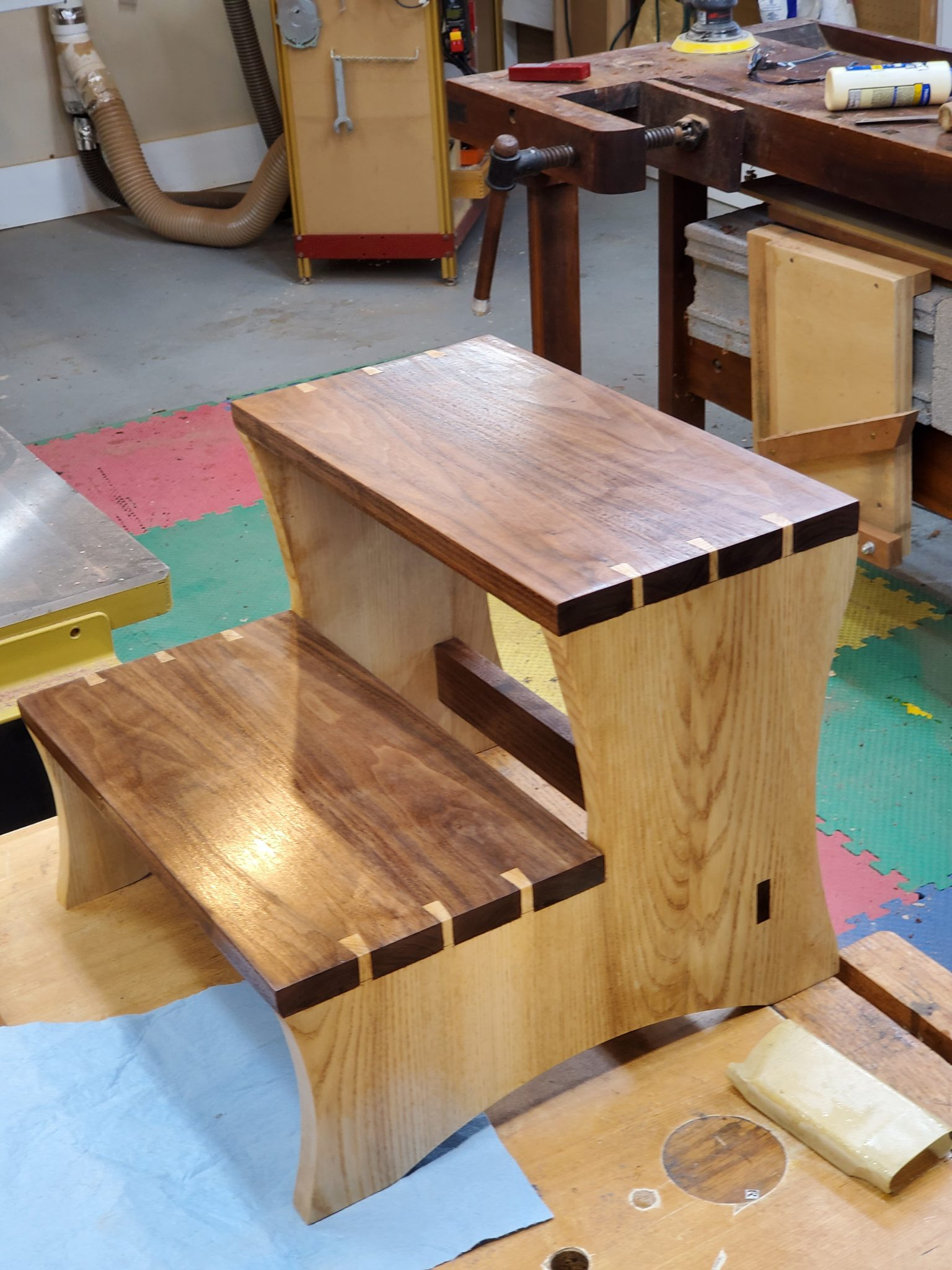 Walnut and ash step stool with hand cut dovetails