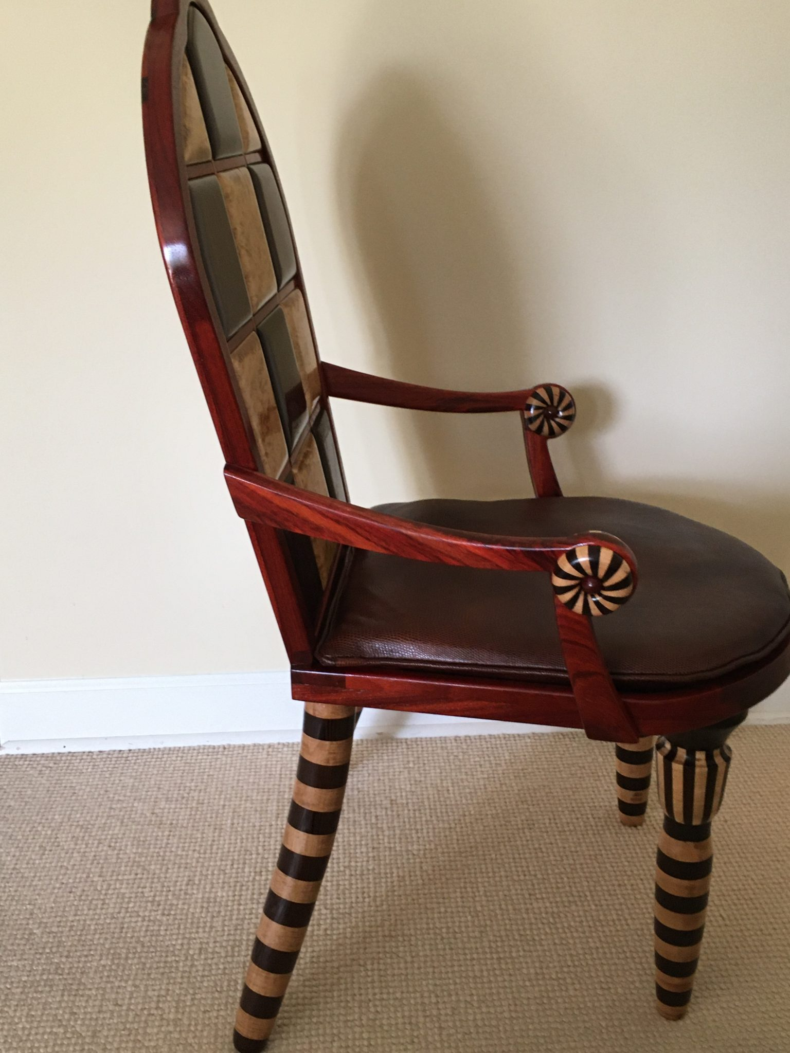 Whimsical chair inlayed with multiple exotic wood species combined with segmented turnings.