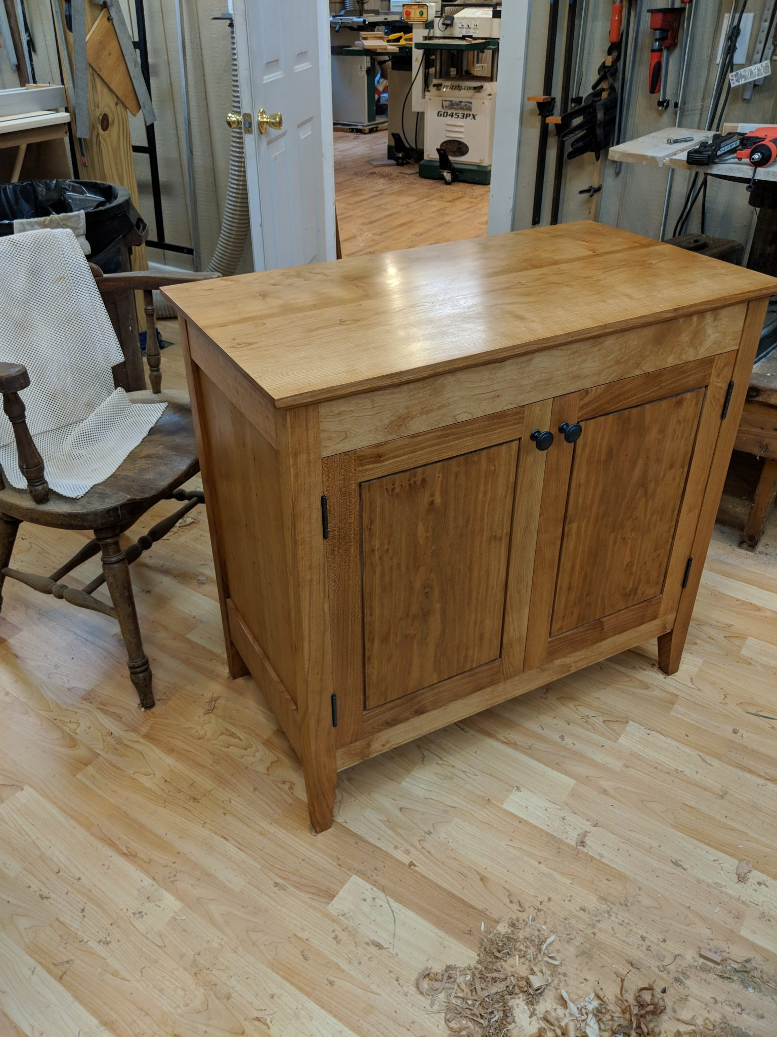 Cherry solids and plywood custom cabinet with shaker doors