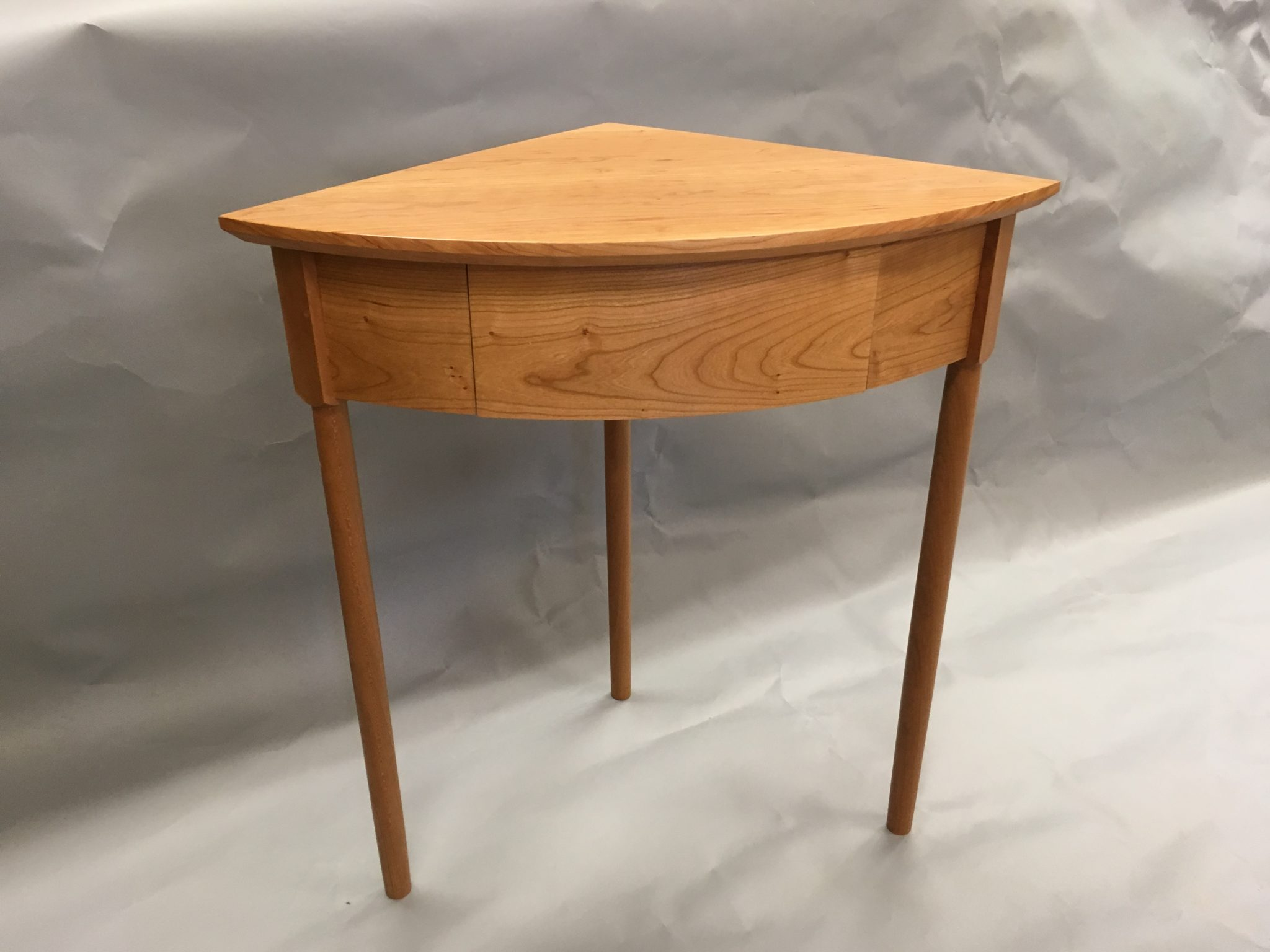 3 leg corner table in cherry with drawer
