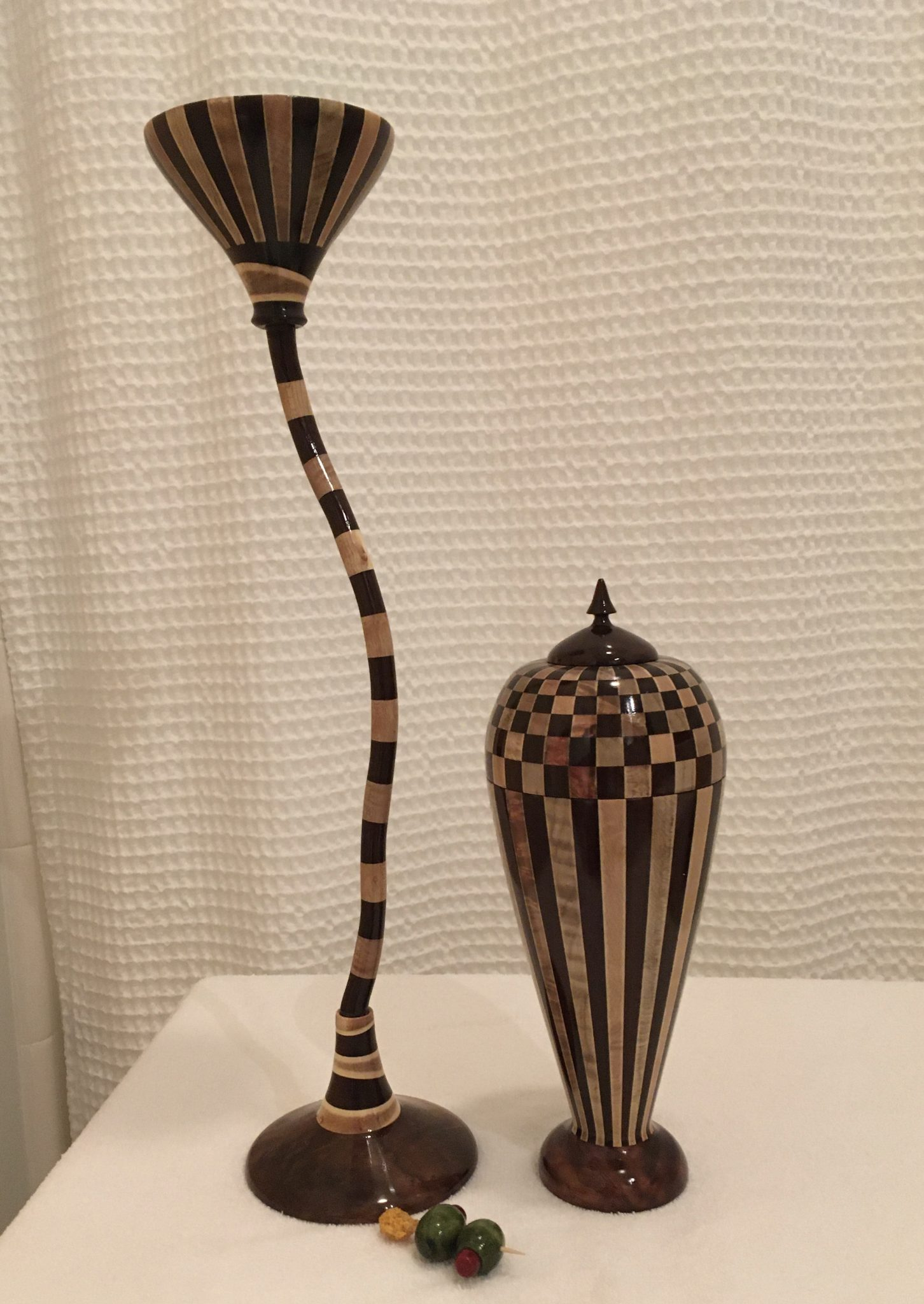 Segmented turning martini glass, cocktail shaker, olives and tooth pick