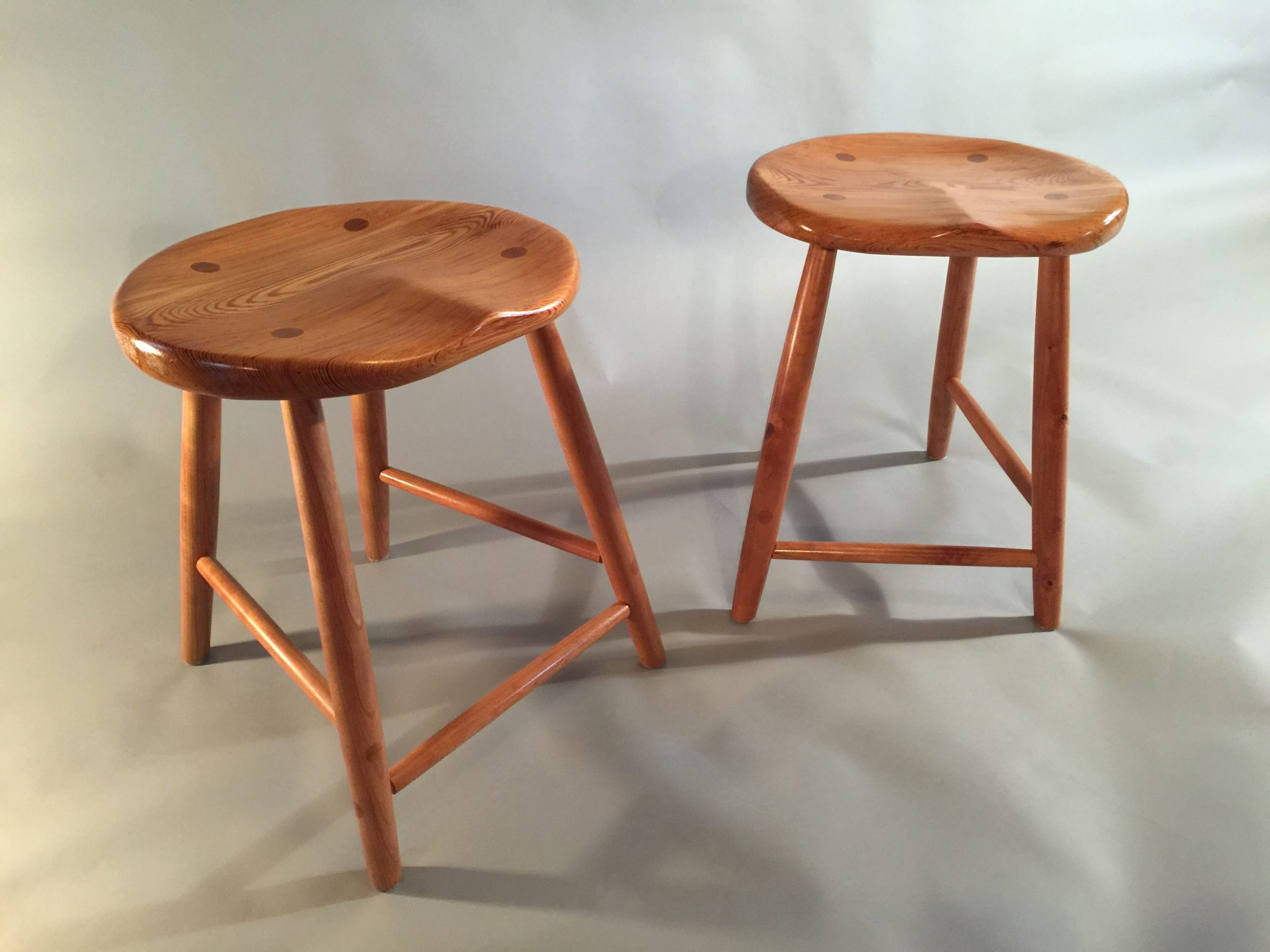 Hand carved yellow heart pine seats with hand turned cherry legs and stretchers