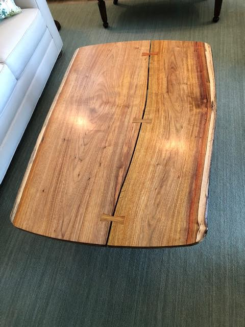 Exotic wood live edge coffee table with butterfly inlay.