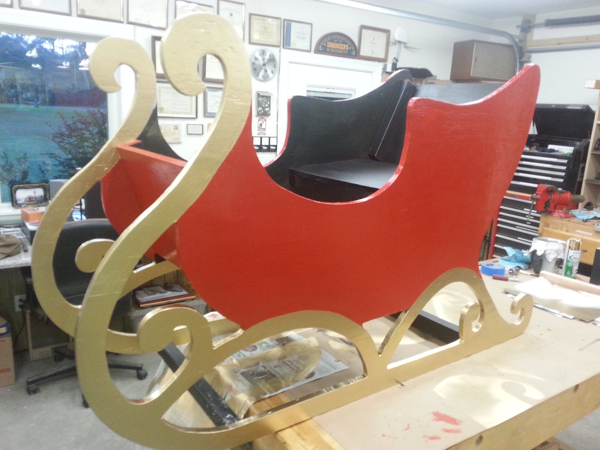 The sleigh sides were made of 1 sheet of plywood and painted. Plywood boxes were decorated by others to become Christmas gifts