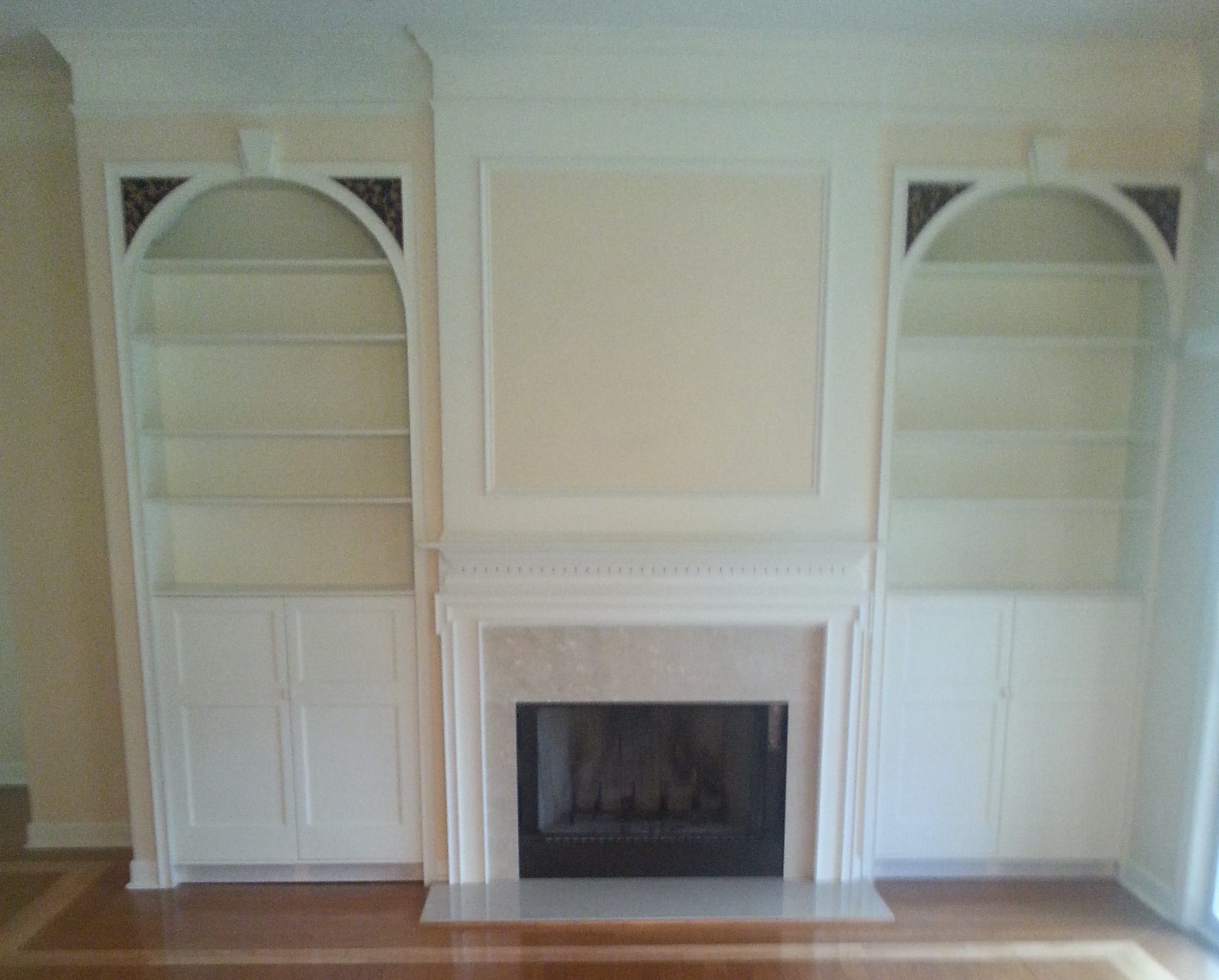 Cabinets with A/V accommodations and speakers built into my former house.  Hand carved mahagony floral vine grilles.  Secret compartment.