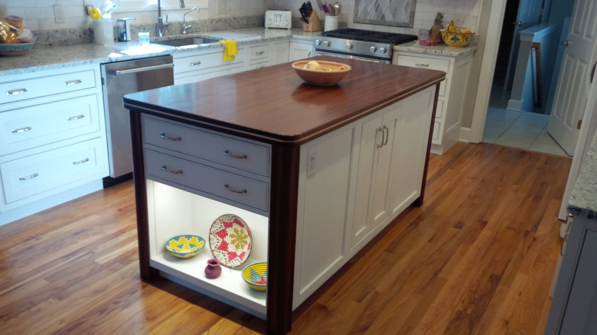 Kitchen Island (7' x 3') is constructed of a Sapele Top, Mahogany Legs and Plywood and Cherry Cabinetry