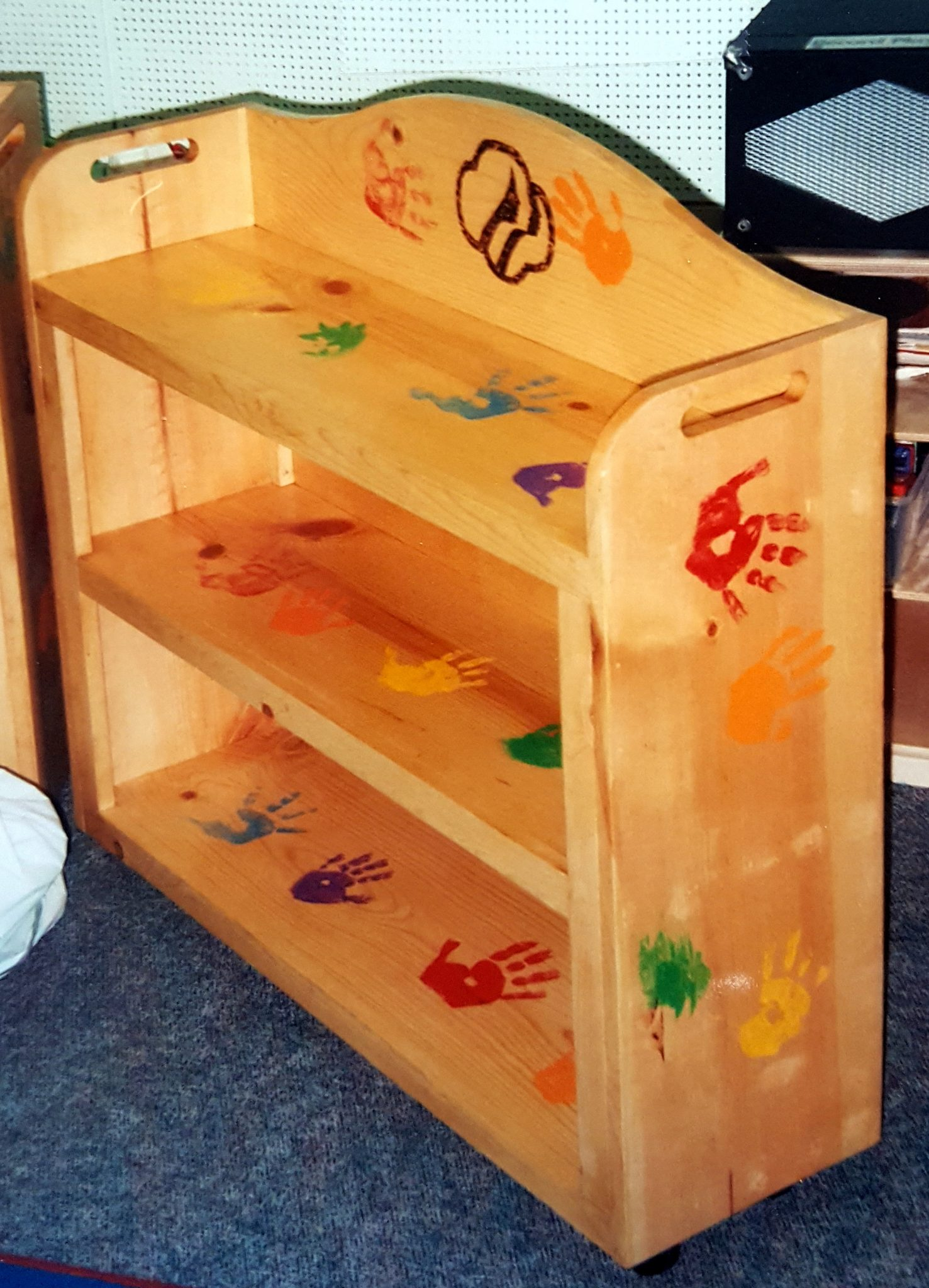 Simple shelf units for the storage of toys.  Made for The Center For Battered Women, Rochester NY.  A project of the Henrietta Girl Scout Troup.
