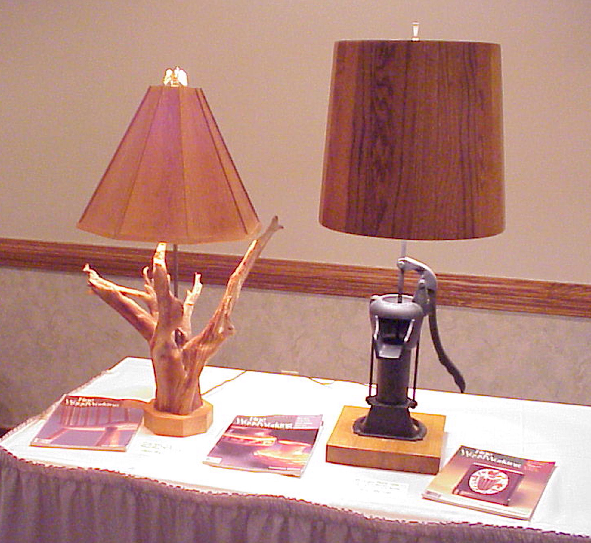 Oak and Pine Table Lamps.  The one with the Pine Shade has a Pine tree root taken from a colonial american farmers fence line.  The one with the Oak Shade has an antique Pitcher Pump as a base.