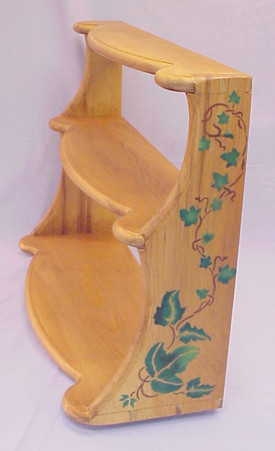 Pine Wall hanging shelf with polychrome stenciled decoration, and hand cut dovetails.