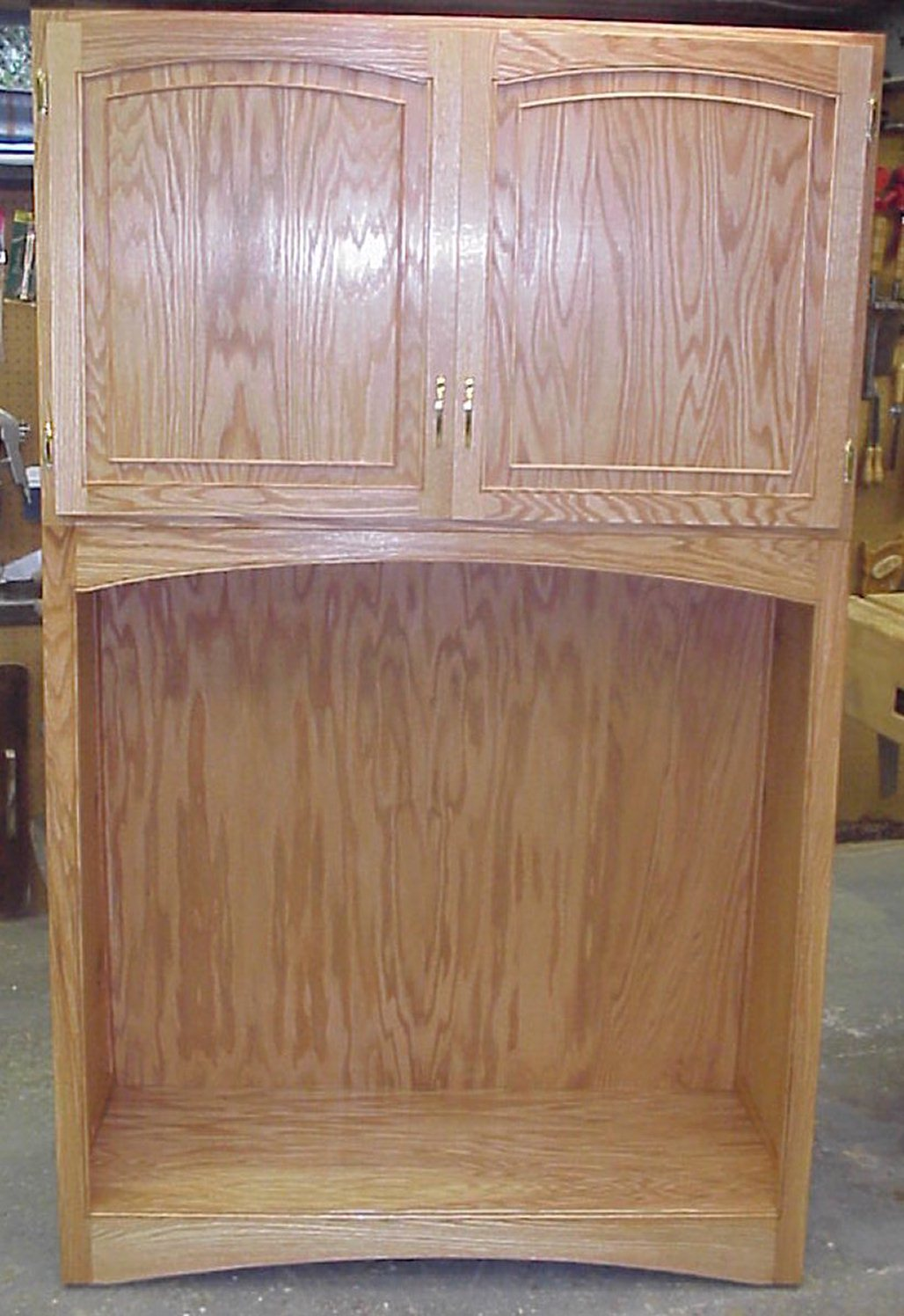 Oak Plywood cabinet designed to house rolls of plotter paper for the Strong Museum, Rochester NY.  The cabinet was designed using faux raised panels.