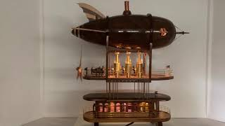Steam punk zeppelin made out of wood. Steam engines power the prop. Interior is detailed and lighted.